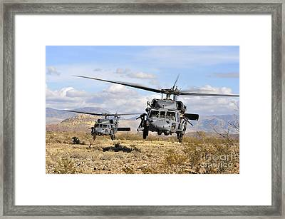 Two Hh-60 Pavehawk Helicopters Framed Print by Stocktrek Images
