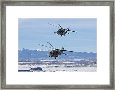Two Hh-60g Pave Hawks Fly In Formation Framed Print by HIGH-G Productions