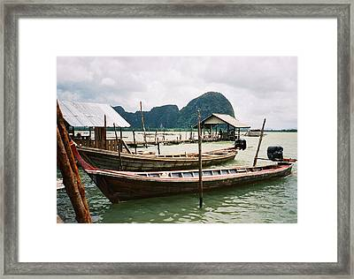 Two Long Boats In A Bay Framed Print