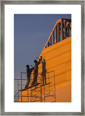 Two Men Build A New Towhouse Framed Print