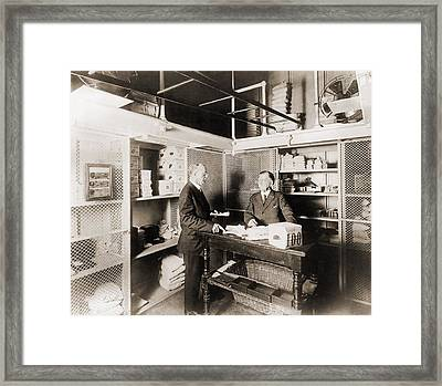 Two Men In Vault At The Treasury Framed Print by Everett