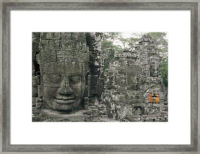 Two Monks In Orange Robes Stand Framed Print by Paul Chesley