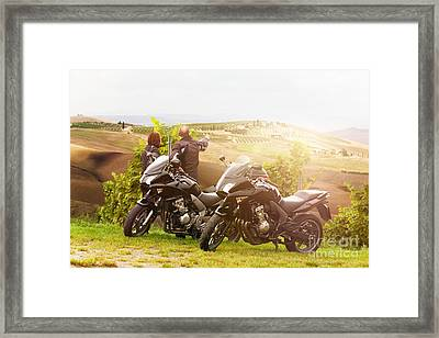 Two Motorcyclists Enjoying The View In Tuscany Framed Print by Wolfgang Steiner
