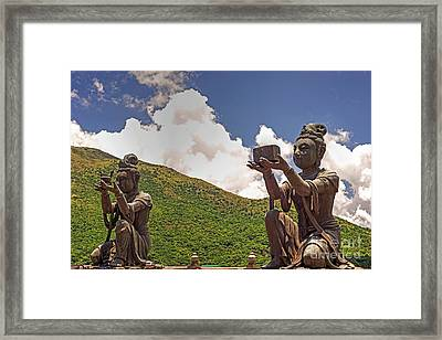 Two Of The Six Devas Give Offerings To The Tian Tan Buddha Framed Print by Chris Smith