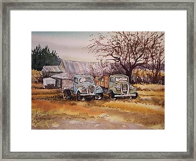 Two Old Trucks Framed Print