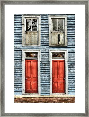 Two Red Doors Framed Print by Mel Steinhauer