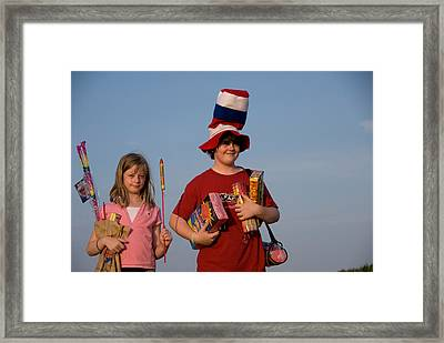 Two Siblings Hold Fireworks On A Gravel Framed Print by Joel Sartore