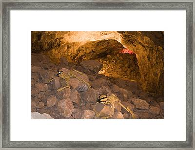 Two Skeletons Crawl Up A Rocky Hill Framed Print by Taylor S. Kennedy