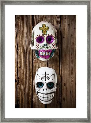 Two Skull Masks Framed Print