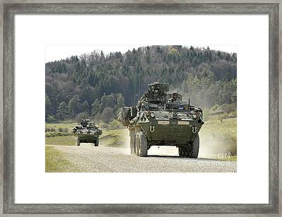 Two Stryker Vehicles At The Hohenfels Framed Print by Stocktrek Images