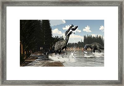Two Suchomimus Dinosaurs Catch A Fish Framed Print by Elena Duvernay