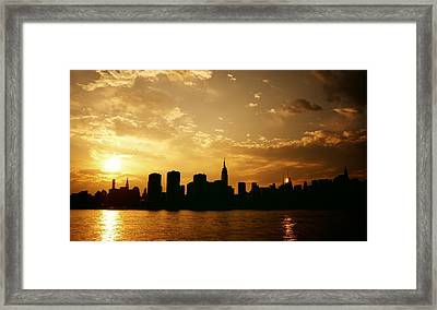 Two Suns - The New York City Skyline In Silhouette At Sunset Framed Print by Vivienne Gucwa
