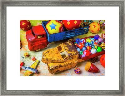 Two Toy Trucks Framed Print