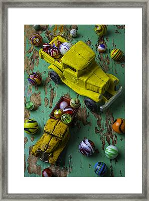 Two Toy Trucks With Marbles Framed Print by Garry Gay