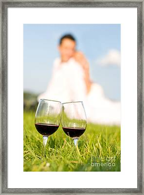 Two Wineglasses With Red Wine In Grass  Framed Print by Arletta Cwalina