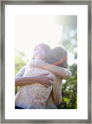 Two Women Hugging Each Other Framed Print by Gillham Studios