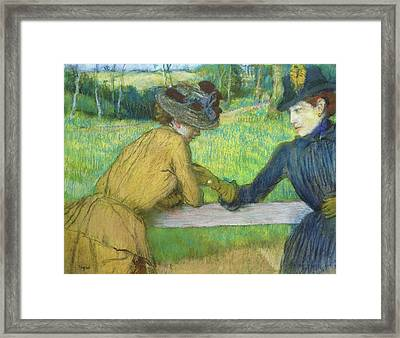 Two Women Leaning On A Gate Framed Print by Edgar Degas