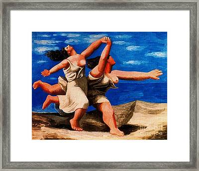 Two Women Running On The Beach Framed Print