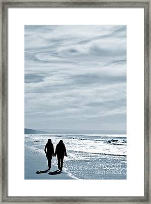 Two Women Walking At The Beach In The Winter Framed Print by Jose Elias - Sofia Pereira
