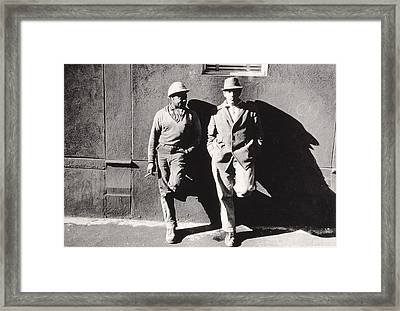 Two Workmen Against A Building Framed Print