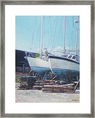 Two Yachts Receiving Maintenance In A Yard Framed Print by Martin Davey