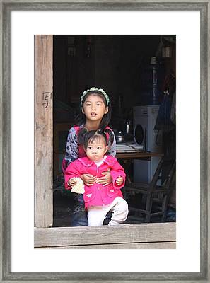 Two Young Chinese Girls In Door Of Hutong House Framed Print