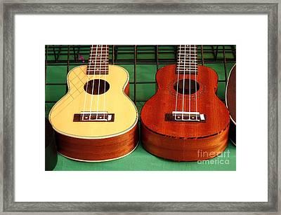 Ukulele Instruments For Sale At A Market Framed Print by Yali Shi