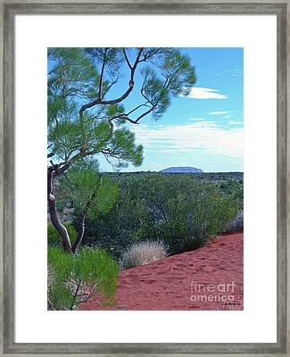 Uluru From Lasseter Highway Framed Print by Phil Banks