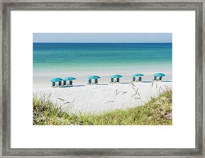 Umbrellas Await On The Beach Framed Print