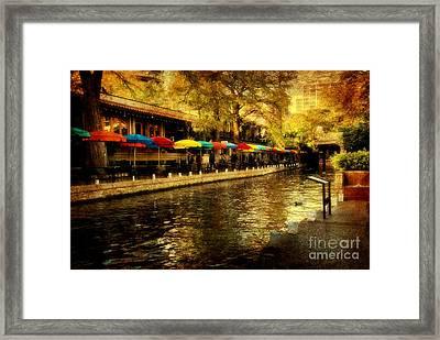 Umbrellas In The Riverwalk Framed Print by Iris Greenwell