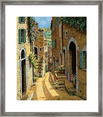 Un Passaggio Tra Le Case Framed Print by Guido Borelli