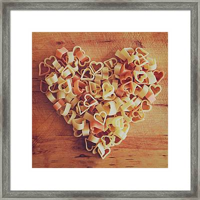 Uncooked Heart-shaped Pasta Framed Print by Julia Davila-Lampe