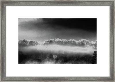 Under A Cloud Framed Print by Steven Huszar