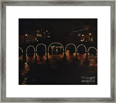 Under A Lighted Bridge In Amsterdam Framed Print