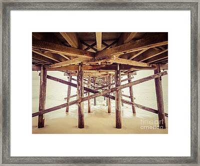 Under A Southern California Pier Framed Print by Paul Velgos