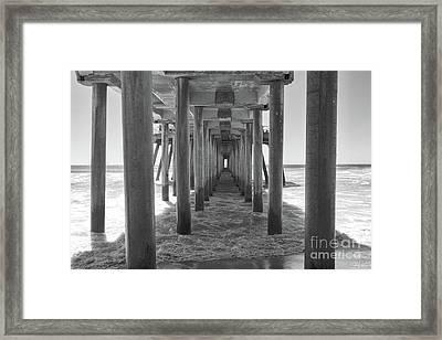 Framed Print featuring the photograph Under Huntington Beach Pier by Ana V Ramirez