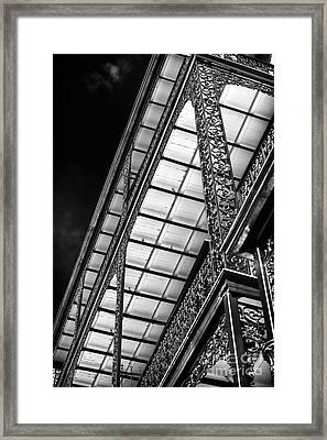 Under The Balcony Framed Print by John Rizzuto