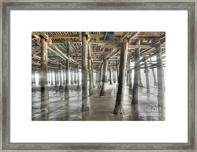 Framed Print featuring the photograph Under The Boardwalk Into The Light by David Zanzinger