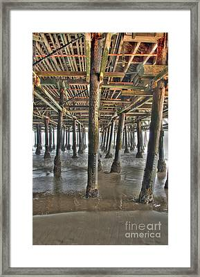 Framed Print featuring the photograph Under The Boardwalk Pier Sunbeams  by David Zanzinger