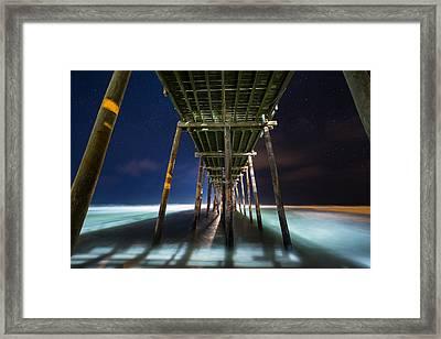 Under The Pier Framed Print by Bryan Bzdula