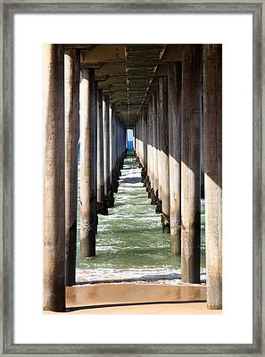 Under The Pier In Orange County California Framed Print by Paul Velgos