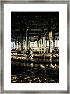 Under The Pier Framed Print by Martin Newman
