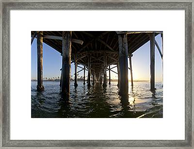 Under The Pier Framed Print by Sean Davey
