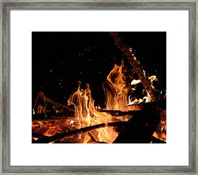 Under The Sparks Framed Print