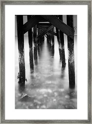 Underneath The Old Jetty Framed Print by Brian Bjeldbak