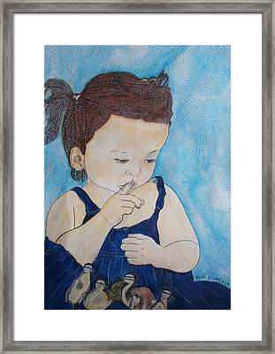 Une Poupee Avec Ses Canetons   A Doll With Its Ducklings   Framed Print by Anne Bazabidila
