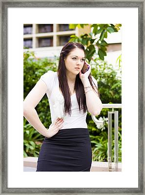 Unhappy Business Woman Talking On Cell Phone Framed Print