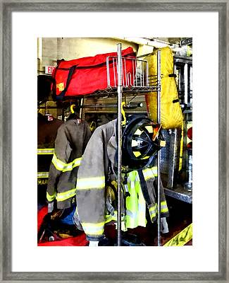 Uniforms Inside Firehouse Framed Print