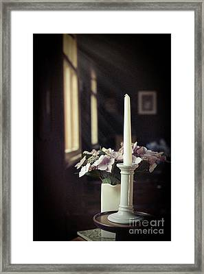 Unlit Candle In Old Church Framed Print by Amanda Elwell
