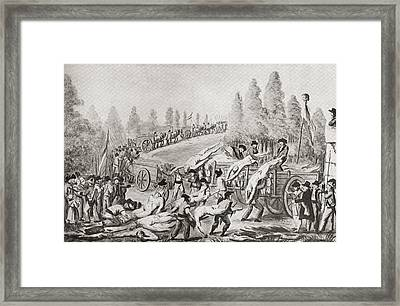 Unloading The Bodies Of Victims During Framed Print by Vintage Design Pics